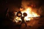 In fuga da Il Cairo in fiamme
